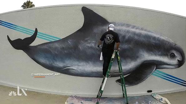 NWF muralist at work