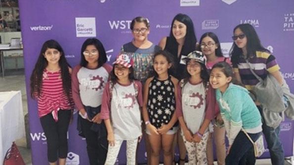 Girls posing for photo at STEM festival